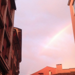 Stock image: rainbow, clouds and buildings